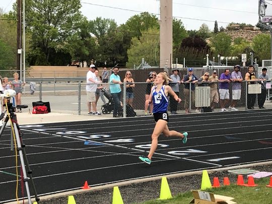 Carson junior Abby Pradere wins the girls 1600 race Saturday in the League meet at Reed.