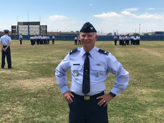 """Steve Shinkle, Abilene ISD's secondary teacher of the year winner, awaits the student-led """"Pass 'N Review"""" military parade at Cooper High School, where his Air Force Junior ROTC students celebrated the end of their school year's events May 2, 2018."""