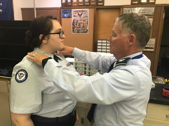 Cooper High School teacher Steve Shinkle, right, fixes the collar of Faith Deems, a freshman in the Air Force Junior ROTC program, before the start of a military parade May 2, 2018. Shinkle was recognized that year as secondary teacher of the year by the Abilene Education Foundation during its Teachers in the Limelight Celebration.