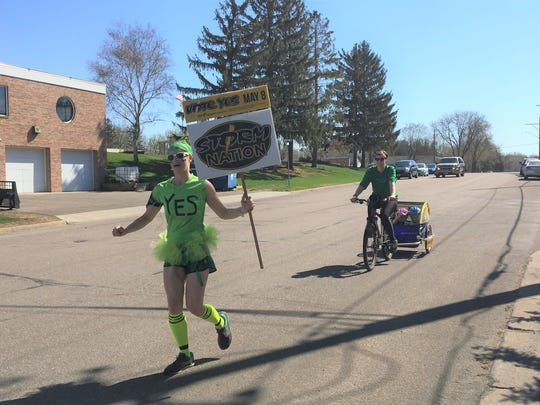 Lori Ruff runs a half marathon on Sunday, May 6, 2018 to encourage fellow Sauk Rapids-Rice residents to vote 'yes' for the referendum on Tuesday, May 8.