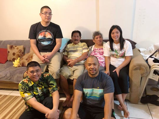 Bernadetta Atalig Lingao Lingao is surrounded by her family in a recent personal photo. After she suffered a stroke in March, her two sons serving in the military flew home to spend time with her, said her daughter Amy Doreen Lingao Lingao.