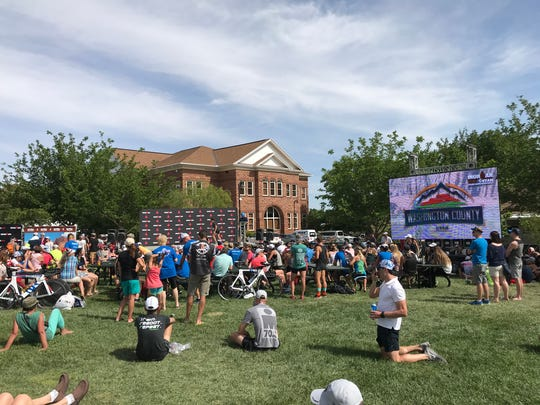 Athletes and fans gather at Ironman Village at St.