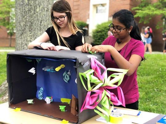 Seventh-grader Katie Antrican (left) and eighth-grader