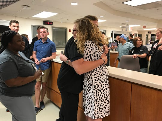 Meredith Petrus hugs nurse Wyatt Humble, who helped treat Petrus while she was in the Mercy Hospital ICU earlier this year.