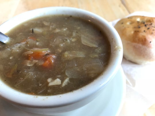 Hearty soup with a roll makes for an inexpensive, but