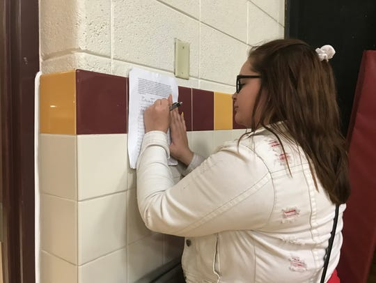 Elice Niedermeier signs a petition calling for School