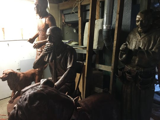 In Brian Hanlon's sculpture studio (left to right): Boston Marathon legend John Kelley and dog Brutus, UNLV basketball coach Jerry Tarkanian, and St. Padre Pio.