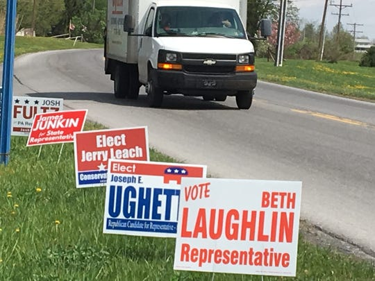 Campaign signs adorn Path Valley road prior to Pennsylvania's primary election on Tuesday, May 15, 2018.
