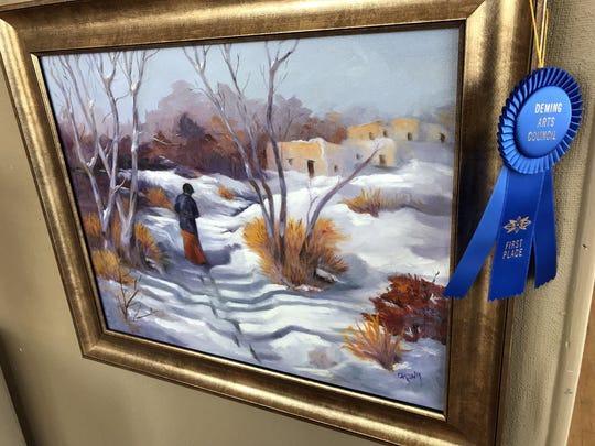 """Local favorite Lyn Orona placed first ion the 2-dimensional division with her painting """"Early Snow."""""""