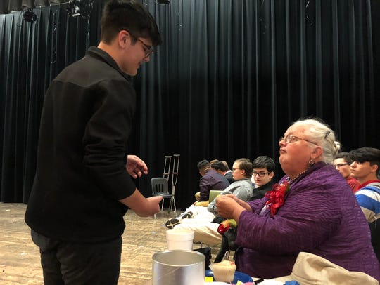 Becky Fly talks with Theater I student Evan Davis at