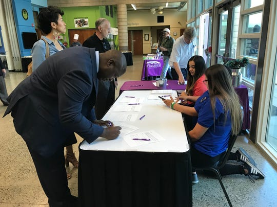 Tulare Mayor Carlton Jones signs a letter of support asking for state financing to open the Tulare Regional Medical Center after the State of the City address at the AgTAC on Friday.