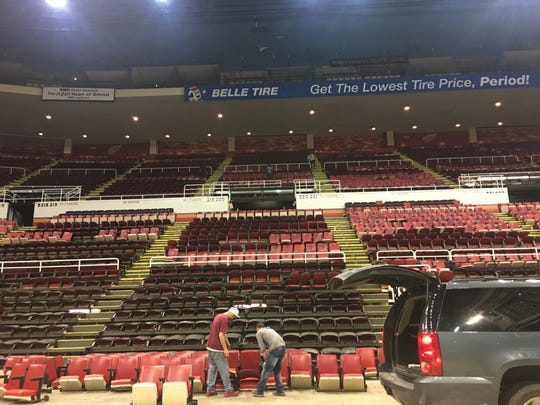 Workers remove chairs from the Joe Louis Arena on May