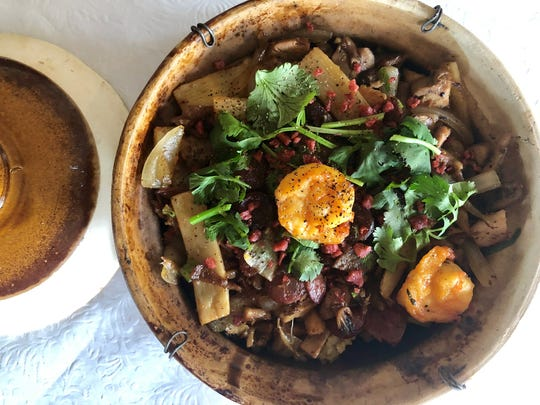 Viet Village's clay pot features a base layer of rice topped with vegatables, pork and shrimp.