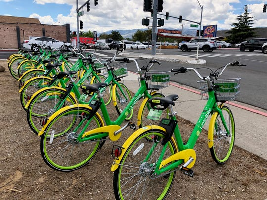 Nine dockless LimeBikes are parked on the corner of Wells Avenue and Ryland Street. LimeBike launched in Reno on May 14, 2018.
