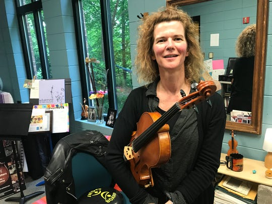 Katie Dey in her office at the Governor's School for Arts and Humanities.