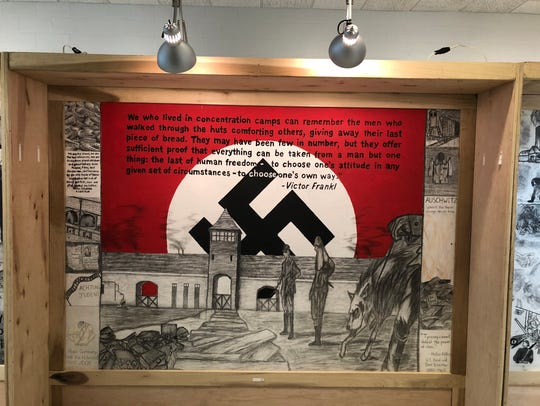 A mural panel is seen from the Holocaust exhibit that