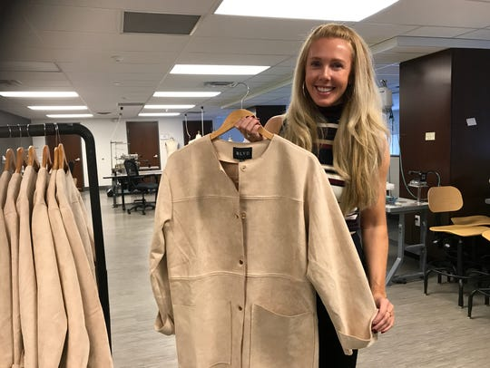 Devon Bradley shows off one of the jackets she carries
