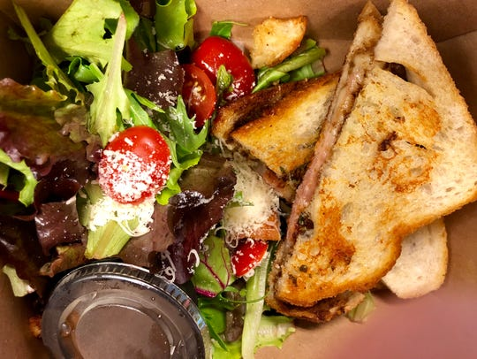 A Gruyere and prosciutto grilled cheese and side salad
