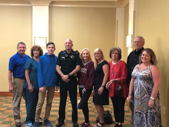 Deputy Patrol Officer for the Madison County Sheriff's Office Mark Ahlquist was honored as the officer of the year by the Jackson Exchange Club. Ahlquist was surprised by his family at the event.