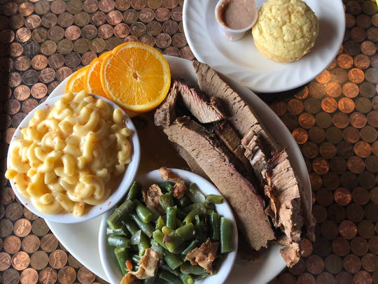 Brisket, mac 'n' cheese, bacon green beans, and a cornbread