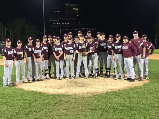 Members of the Verona baseball team pose with the trophy after defeating Cedar Grove in the annual rivalry game at Yogi Berra Stadium.