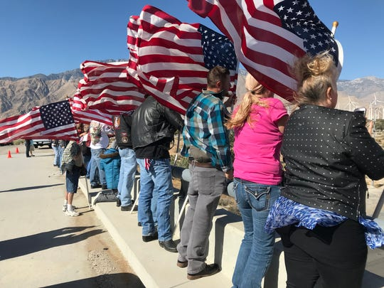 A small group of desert locals took to the Wall Bridge above Interstate 10 in north Palm Springs Wednesday morning to salute Southern California motorcyclists headed to Vietnam Veterans Memorial in Washington D.C. as part of the 30th annual Run for the wall.