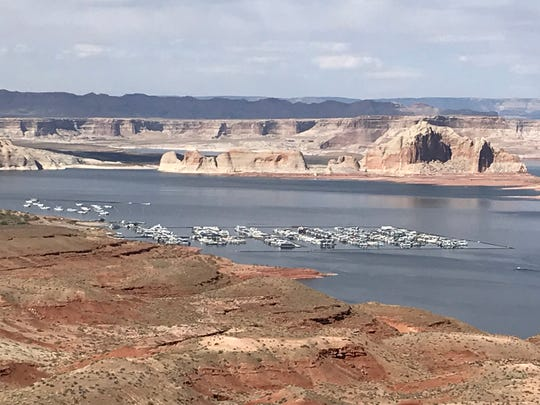 Lake Powell is a popular destination for swimmers and boaters.