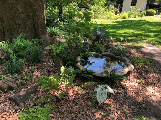 A birdbath at the home of Jane Daniel and her  Philip Parsons.