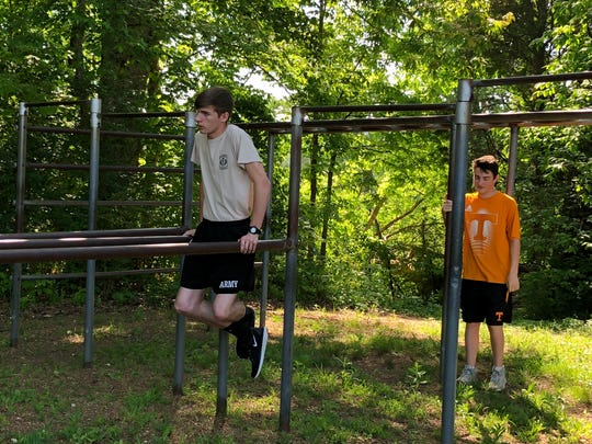 Cadet Zach Reece leads the JROTC members through physical