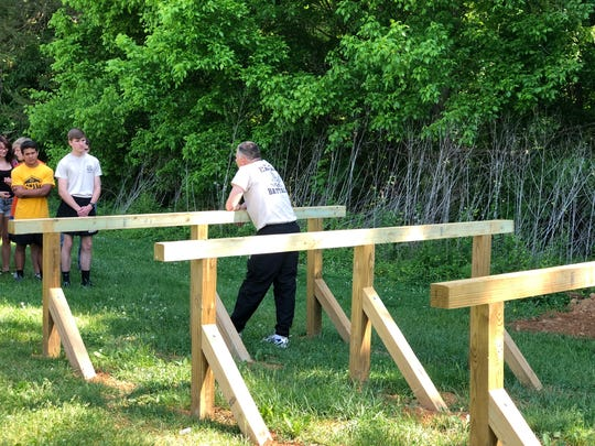 """Colonel Robert Reed talks to the JROTC about the """"Six-Vault"""" obstacle."""