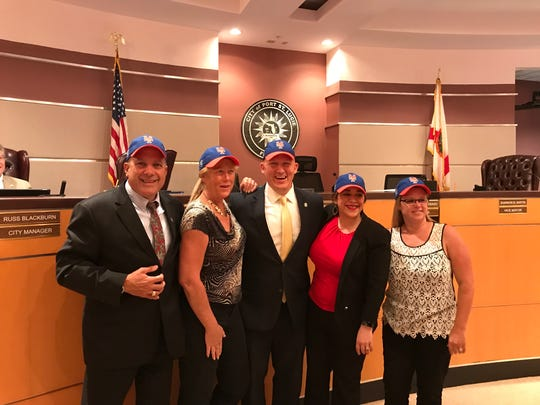 The Port St. Lucie City Council poses with New York Mets hats.