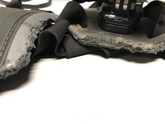 A small animal chewed on the rubber part of the harness.
