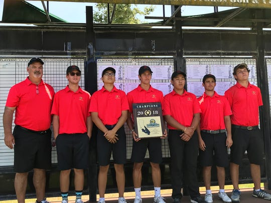 Kurt Ney, seen here to the left with the 2018 Palm Desert boys golf team, has resigned as the coach of the girls golf team at the school but will remain as the boys coach.