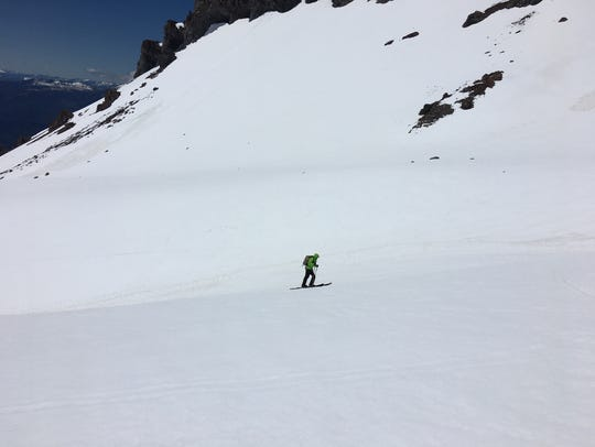 A skier ascends Avalanche Gulch on Mt. Shasta on May