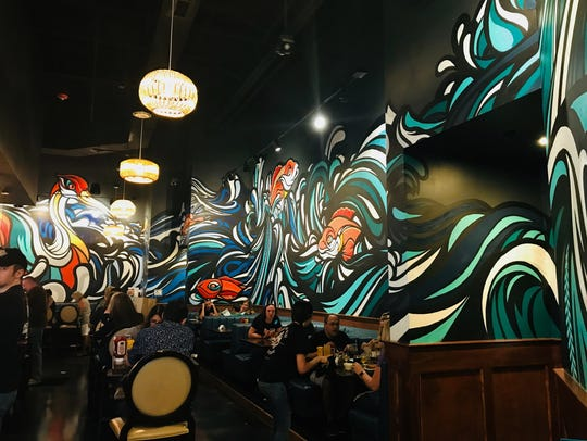 HopCat's dining area with huge murals. The Treasure