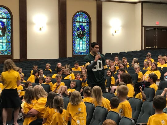 Green Bay Packers linebacker Blake Martinez answers CELA students' questions during an assembly that honored the school's achievement of raising more than $7,000 for childhood cancer research.