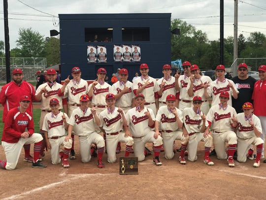 The Plymouth Big Red baseball team poses for a team