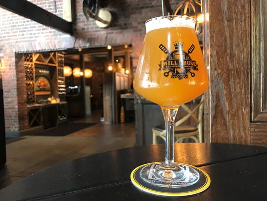 A glass of Grocery Getter, a New England IPA from Mill