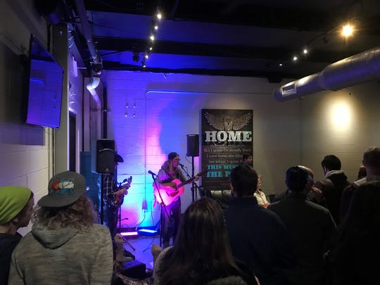 Adam Stephen Johnston performs at Tie & Timber Beer Co in a recent show booked by Compass Rose.