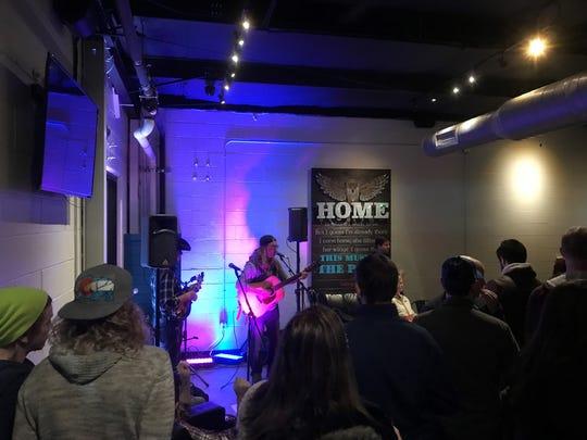Adam Stephen Johnston performs at Tie & Timber Beer