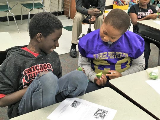 Jamond Butler-Spencer and Bradley Williams, 3rd grade students at Bond Elementary, discussing their reactions to trying the Brussels sprouts.