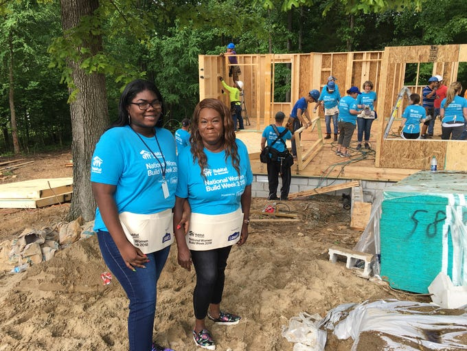 Homeowner Pamela Barr (right) is pictured with her