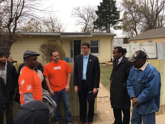 Community members gathered on Anderson Drive in Dunleith to celebrate the home renovation of Delaware Army National Guard veteran Willis Phelps, Jr. Pictured from left: William Mayer (in hat), Philip Pisani of Home Depot, County Executive Matt Meyer, City Councilman and Interfaith Community Housing of Delaware employee Nnamdi Chukwuocha, and Phelps.
