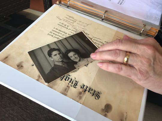 Sherry Sanders shows a photo of her uncle, Marine 2nd Lt. Harvel Lee Moore, with a woman he courted during World War II.