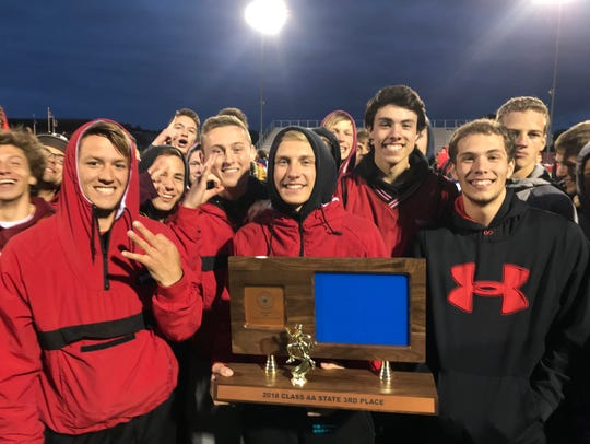 Rocori's boys track and field team shows off the third-place