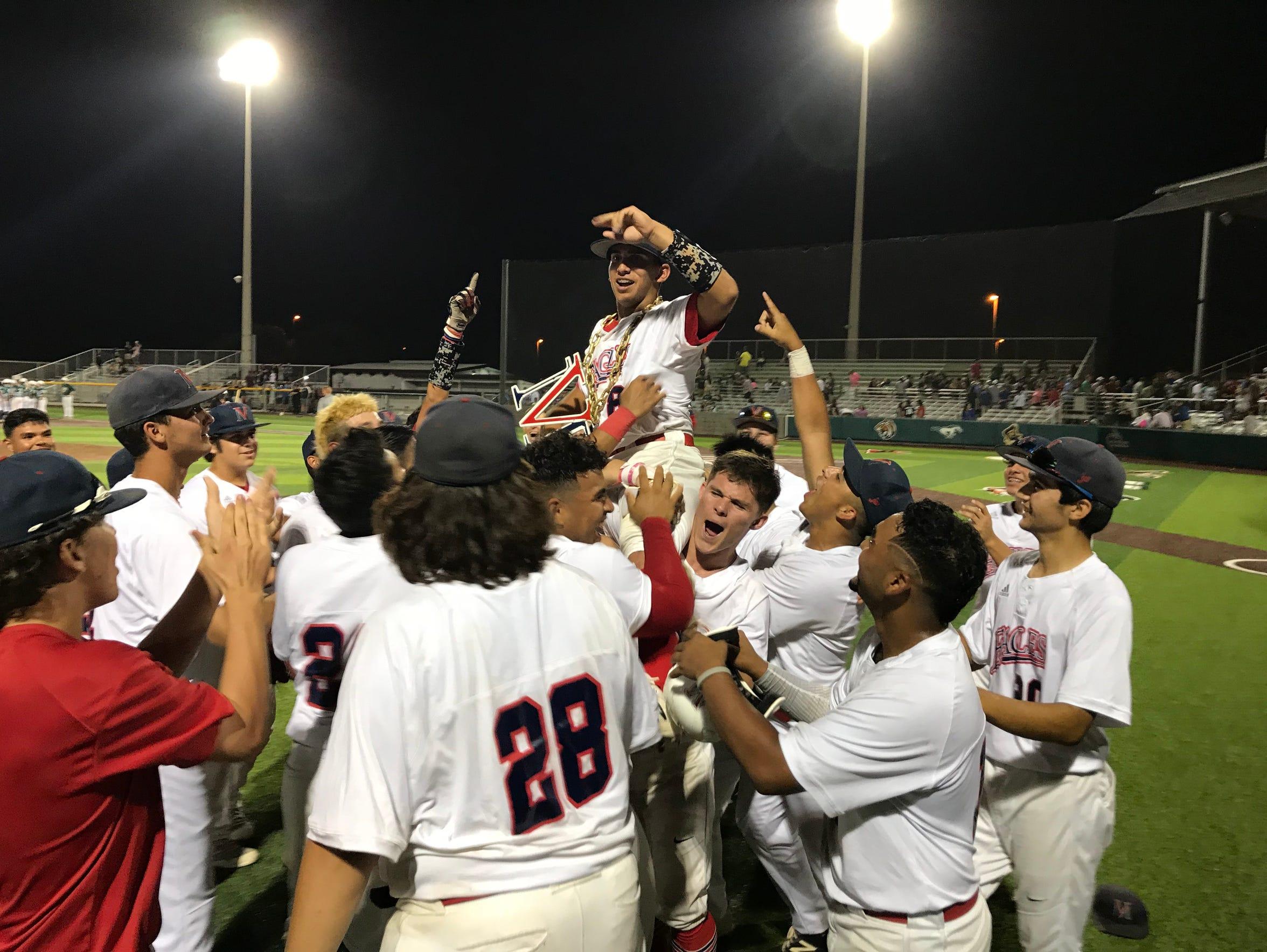 The Veterans Memorial baseball team hoists JT Zepeda