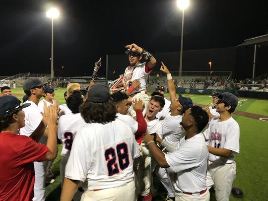 The Veterans Memorial baseball team hoists JT Zepeda in the air after he laced a game-winning RBI double in the bottom of the eighth inning to beat King in the regional quarterfinals at Cabaniss Field, Friday, May 18, 2018.