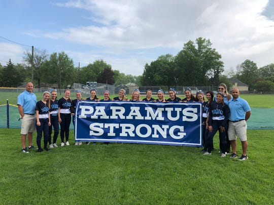Paramus softball players show the new Paramus Strong