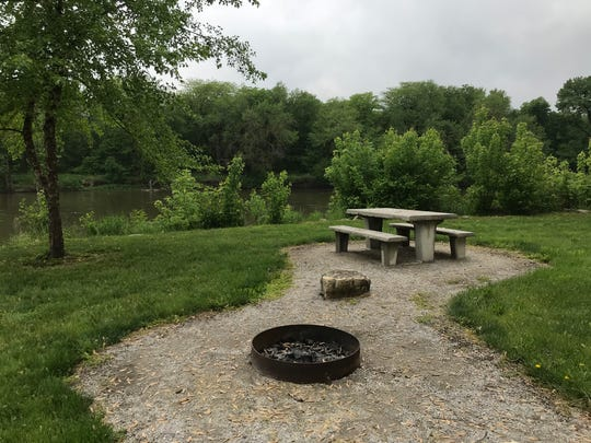 A fire pit and picnic table at River Junction Park