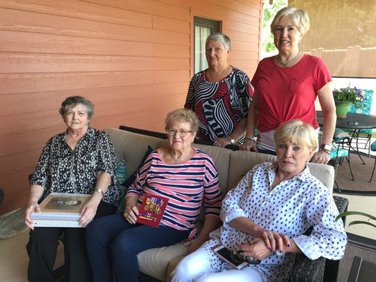 U.S. Marine 2nd Lt. Harvel Lee Moore died 75 years ago during battle. His nieces will get to bury him this week. From row, from left: Sherry Sanders, Billie Sue Meredith, Barbara Norris. Back row, from left: Diane Williams and Patricia Powell.